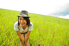 Asia woman  in the grassland Royalty Free Stock Images