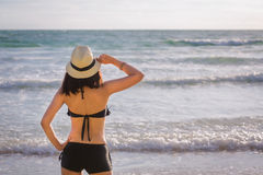 Asia woman with hat and bikini on sea beach Royalty Free Stock Images