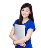 Asia woman holding computer Stock Photos