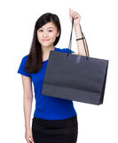 Asia woman holding shopping bag Royalty Free Stock Image