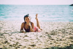 Asia Woman lying and posing on beach. Asia Woman on tropical sandy, lying and posing on beach royalty free stock photo