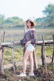Asia woman in summer fashion standing on sun Stock Photos