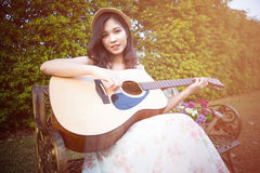 Asia woman playing guitar Stock Photos