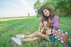 Asia woman playing guitar Stock Image