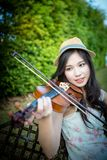 Asia woman playing violin Royalty Free Stock Photo
