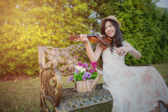 Asia woman playing violin Stock Image