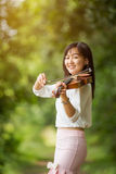 Asia woman playing violin Royalty Free Stock Photo