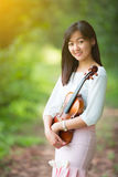 Asia woman playing violin Royalty Free Stock Image