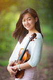 Asia woman playing violin Stock Photo