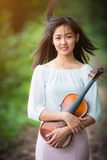 Asia woman playing violin Royalty Free Stock Photography
