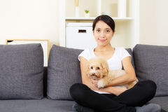 Asia woman and poodle dog. At home Royalty Free Stock Images