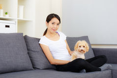 Asia woman and poodle Royalty Free Stock Photo