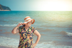 Asia woman posing at beach with blue sea and sky Stock Photography