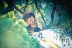 Asia woman posing in park. Portrait of Asia woman posing in park Royalty Free Stock Images
