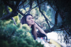 Asia woman posing in park. Portrait of Asia woman posing in park Stock Image