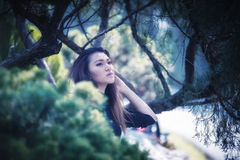 Asia woman posing in park. Portrait of Asia woman posing in park Stock Images