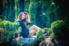 Asia woman posing in park. Portrait of Asia woman posing in park Royalty Free Stock Photo
