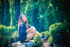 Asia woman posing in park. Portrait of Asia woman posing in park Royalty Free Stock Photos