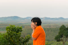 Asia woman posing and scared at mountain view Royalty Free Stock Photos
