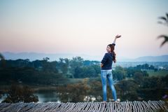 Asia woman posing on view point with mountrain Stock Image