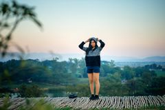 Asia woman posing on view point with mountrain Royalty Free Stock Photo