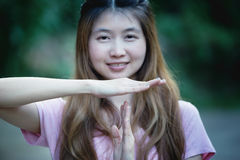 Asia woman shows the hands stop timeout Royalty Free Stock Photo