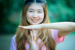 Asia woman shows the hands stop timeout Royalty Free Stock Photography