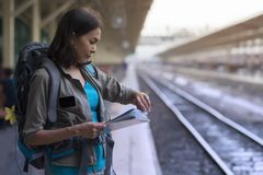 Asia woman stand wait train for traveler trip and checking time royalty free stock photos