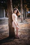 Asia woman standing lying tree in park on sun royalty free stock photo