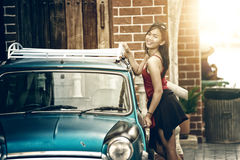 Asia woman standing near door of vintage car Stock Photo