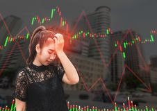 A asia woman stress and headache when stock market fall Stock Photography