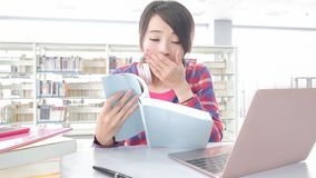 Woman student in the library Royalty Free Stock Photo