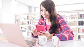 Woman student in the library Stock Photography