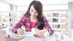 Woman student in the library Stock Images