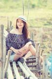 Asia woman in summer fashion sitting on sun Stock Photography