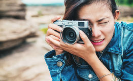 Asia woman taking a photo Royalty Free Stock Images