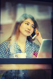 Asia woman talking  phone in cafe and enjoying coffee Stock Photo