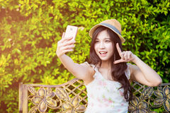 Asia woman use smartphone take photo Stock Photography