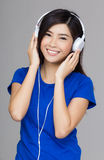 Asia woman using her headphone Stock Images