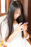 Asia Woman Using Mobile Phone  At Home Royalty Free Stock Photo
