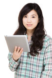 Asia woman using tablet Stock Image