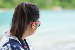 Asia woman wearing sunglasses looking scenery view front of hers Royalty Free Stock Image