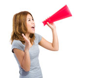 Asia woman yelling through megaphone Stock Images