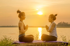 Asia woman yoga on sunset Stock Images