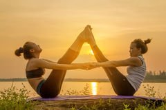 Asia woman yoga on sunset Stock Photography