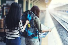 Asia women with bag backpack and map, preparing for traveler trip at train station. Asia women with bag backpack and map, preparing for traveler trip at train royalty free stock photos