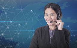 Asia women happy smiling customer support operator with headset Stock Image