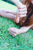 Asia women lying with Hand showing thumb  down Stock Photos