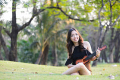 Asia women playing Ukulele Royalty Free Stock Photos