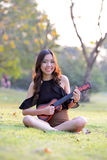 Asia women playing Ukulele Stock Photo